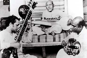 Ustad Allauddin Khan teaching Ravi Shankar & his son, Ali Akbar Khan